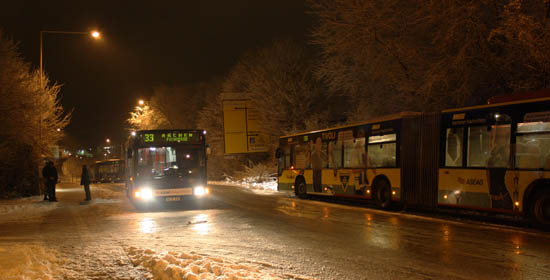 Three buses are standing at the crossroads, two of them have folded